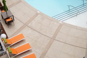 The Edge Luxury Apartments in Tulsa installed Bomanite Exposed Aggregate Alloy System Concrete Pool Deck