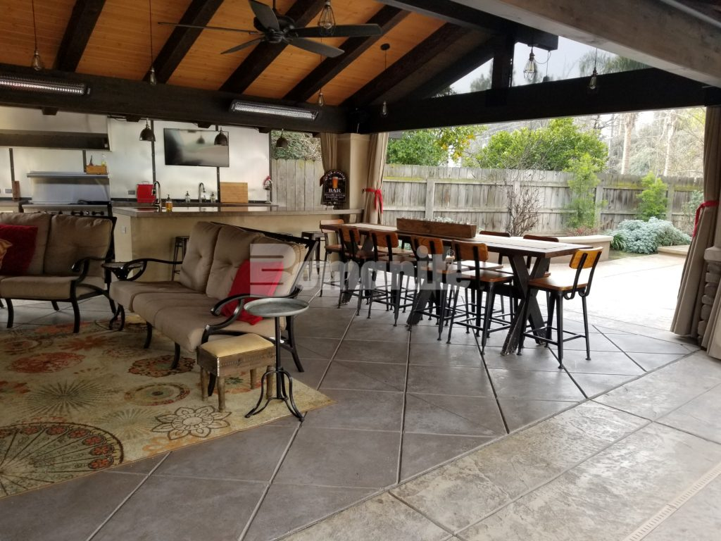 Bomanite Designer Backyard Ideal for Enterntaining with Imprinted Concrete Pool Deck and Exposed Aggregate Antico Firepit Seating and Cabana Flooring